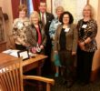 Sen. John Eklund (3rd from left) with members Kathleen Rizer, Sandra Smith, Tanya Verga, Catherine Fallick and Elizabeth Dick
